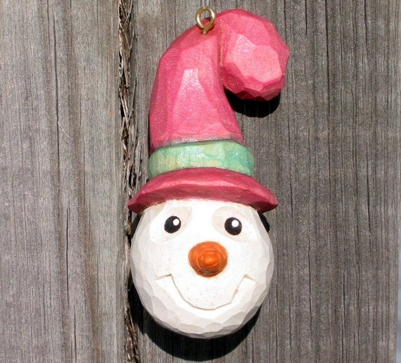 Smiling SNOWMAN WOOD CARVING Ornament, Pearl Pink & Green Hat - Hand Carved - Winter Decoration