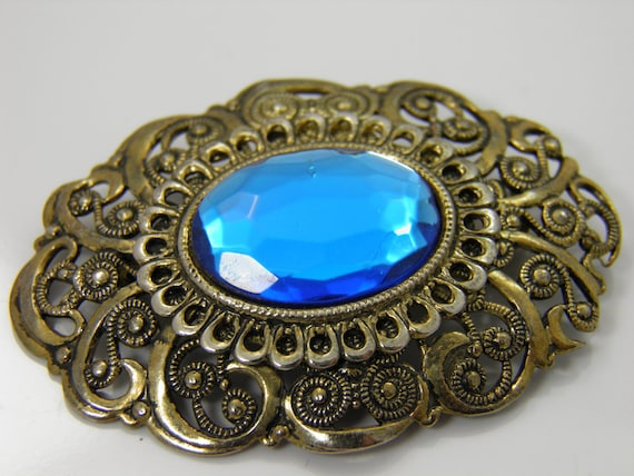Vintage Victorian Style Ornate Antique Goldtone Brooch With Vibrant Cobalt Sapphire Oval Rhinestone