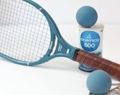 Wilson racquetball racket with TWO balls