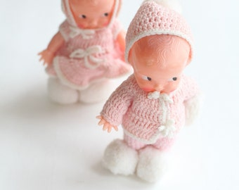 Kewpie dolls,  crocheted pink clothes