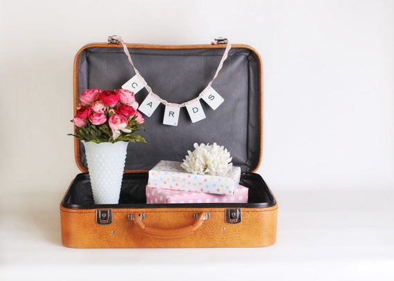 Small honey tan faux leather soft sided suitcase