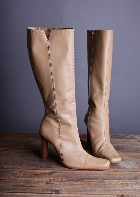 Size 8.5 Women's high heel zip up tan boots