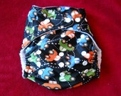 """SassyCloth one size  pocket diaper with """"Cars going around""""  PUL print. Ready to ship."""