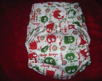 SassyCloth one size pocket diaper with red and green ooga-booga  PUL print. Ready to ship.