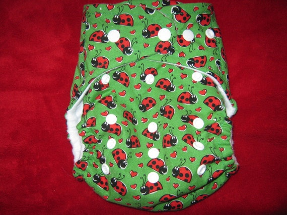 SassyCloth one size AIO pocket diaper with ladybugs print. Made to order.