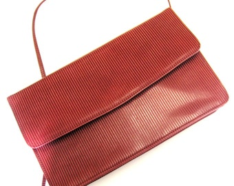 1960s  Andrew Geller Leather Raspberry Ribbed Convertible Clutch