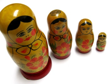 Nesting Dolls Russian Primitive Early Matryoshka Set of Four