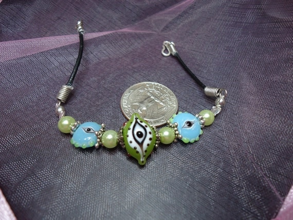 Green & baby blue evil eye bracelet