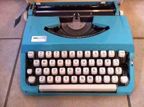 bright blue amazing  working vintage kmart 100 typewriter- reserved