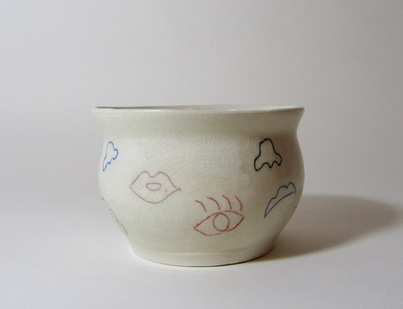 Mixed-Up Face bowl: Lips, eyes, nose, eyebrows all over the place....