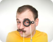 Photobooth props - Mustache and Plastic Monocle with Metal Chain on a Stick - Set of 2
