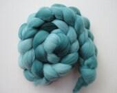 Cedar Falls - A wonderful blue-y Green Merino roving for you to spin.