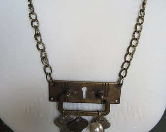 SALE, SALE, SALE!  Vintage Door Plate Necklace with Keys and Charms. As featured in Country Living Magazine.