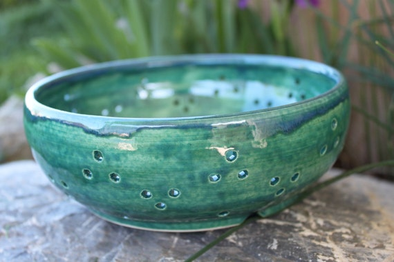 Handmade pottery berry bowl colander in seafoam green with light blue rim, holds over 4 cups