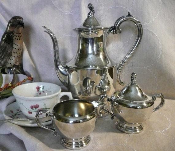 1881 Rogers Silverplate Tea Set, ( Teapot, creamer, sugar)