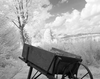 "Black and white photo notecard, 4""x5.6"", of a wheelbarrow in rural New Hampshire."