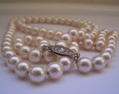 Vintage Faux Pearls strung on a silvertone chain