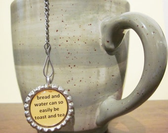 Tea Infuser with Bottle Cap Charm - Bread Water Tea and Toast - 2  inch Tea Ball - Uplifting Charm