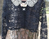 Vintage black lace cardigan style jacket with sequins across bottom and sleeves with lace collar