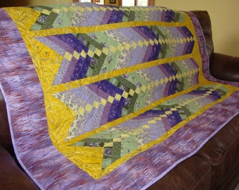 "French Braid Quilt 48"" X 64"", purple, green and yellow; flannel back"