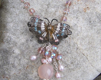 Take Wing and Fly- Pendant necklace and earrings- refashioned vintage Silver Butterfly and pink Crystal