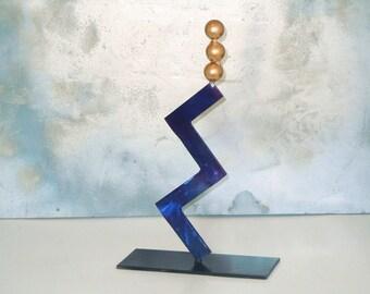Art deco Inspired metal sculpture suspence