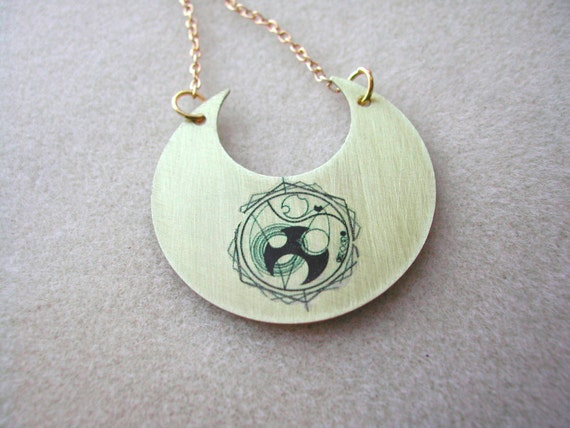 Doctor Who golden crescent with Gallifreyan symbol for TIME