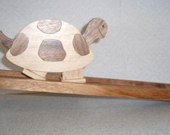 Walking Turtle - Classic wooden toy.  Turtle walks down the ramp.
