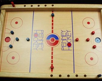 Penny Hockey - Unique fun for all - Flick the penny to score