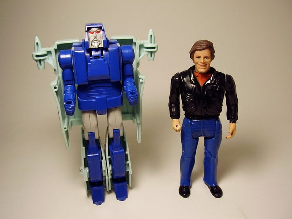 Two Vintage Toy Action Figures a Galoob 1983 A Team Face and a Hasbro Takara Macau 1986 G1 Transformers Decepticon Scourge