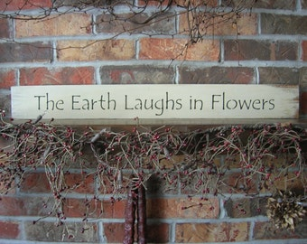 "Wooden Sign ""The Earth Laughs in Flowers"""