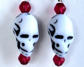 Skull earrings with red