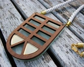Geometric perspex, walnut and brass laser cut necklace.