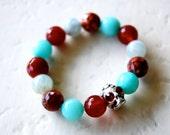 ITSY BITSY SKULL bracelet for boys featuring aquamarine and carnelian gemstones