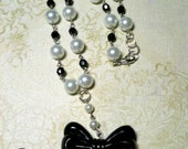 Black tie affair pearl and bow necklace