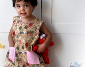 Girl pinafore, fun little village girl apron, toddler vest. Sizes from 6 months to 4 years.