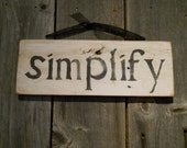 Antique barn wood sign'simplify'