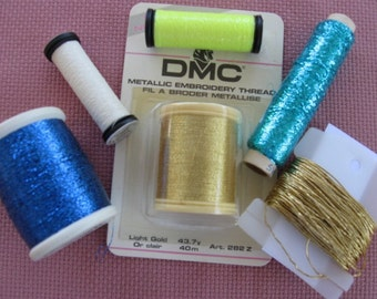 Metallic Threads an assortment of different kinds,  DMC spool, Kreinik, etc.