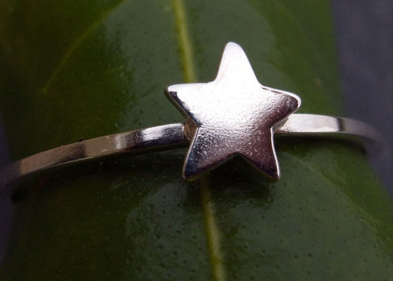 Tiny star stacking ring in sterling silver