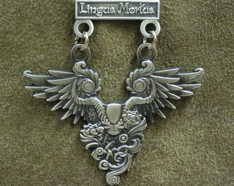 Winged skull military style medal