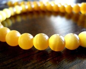 10 Orange Tangerine Cats Eye Round 8mm Glass Beads