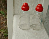 RESERVED for Philippe....1950 Glass, red topped, Salt and Pepper shaker set. Made in USA. Patented markings on bottom