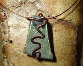 Unique Ceramic Pendant of deep greens and black with coated wire embellishing