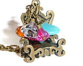 Romantic brass chair charm necklace with blue silver and hot pink flowers and hyacinth teardrop beads