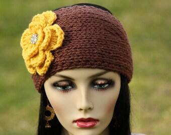 Hand-knit headband/earwarmer ,crochet  flower with very shiny rhinestone button
