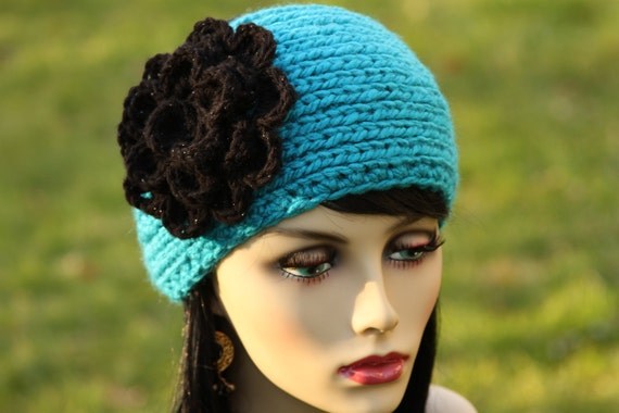 Hand knitted headband/earwarmer, crocheted flower, color in blue and black
