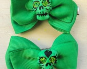 Green Pair of Clay Sugar Skull Hair Bows On Alligator Clip