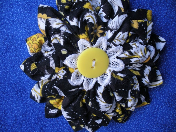 Large flower hair accessory with button medallion center