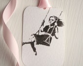 Banksy Swing girl PARK 5 tags labels with a pink ribbon