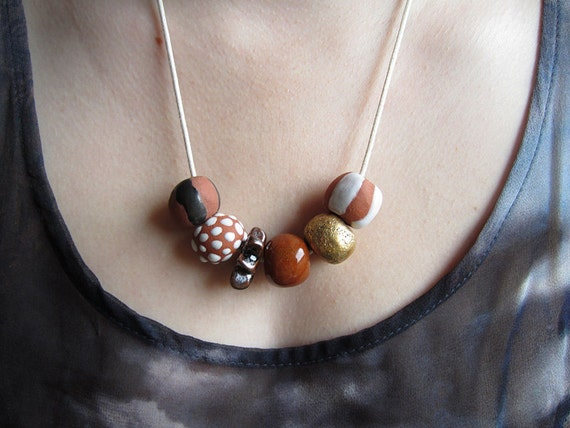 Earthen Gold: Ceramic Bead Necklace
